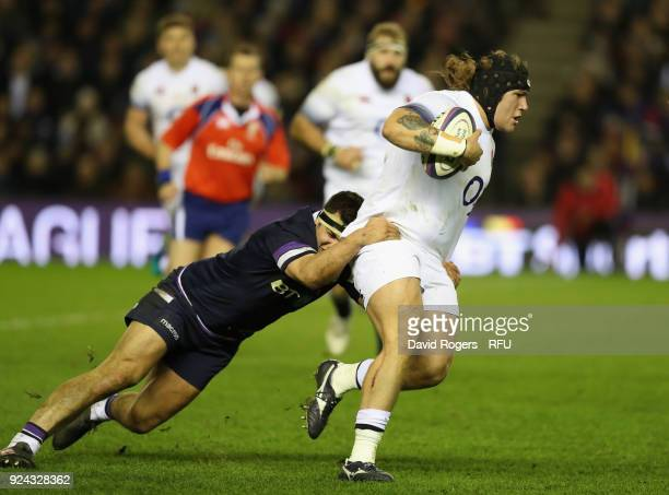 Harry Williams of England is tackled by Ryan Wilson during the NatWest Six Nations match between Scotland and England at Murrayfield on February 24...