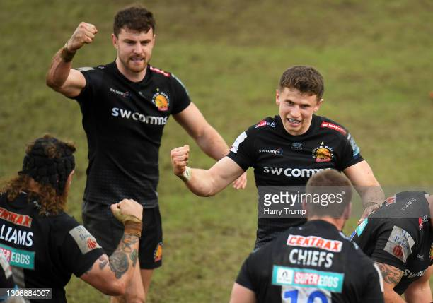Harry Williams, Ollie Devoto and Harvey Skinner of Exeter Chiefs celebrate as Dave Ewers of Exeter Chiefs goes over to score their sides third try...
