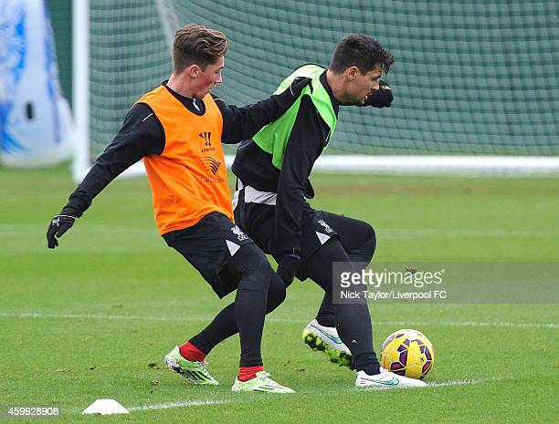 Harry Wilson and Dejan Lovren during a Liverpool FC training session at Melwood Training Ground on December 4 2014 in Liverpool England