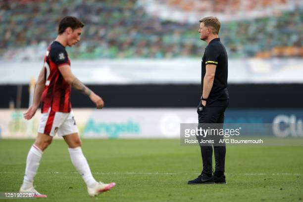 Harry Wilson and Eddie Howe of Bournemouth after their sides 10 defeat during the Premier League match between Wolverhampton Wanderers and AFC...