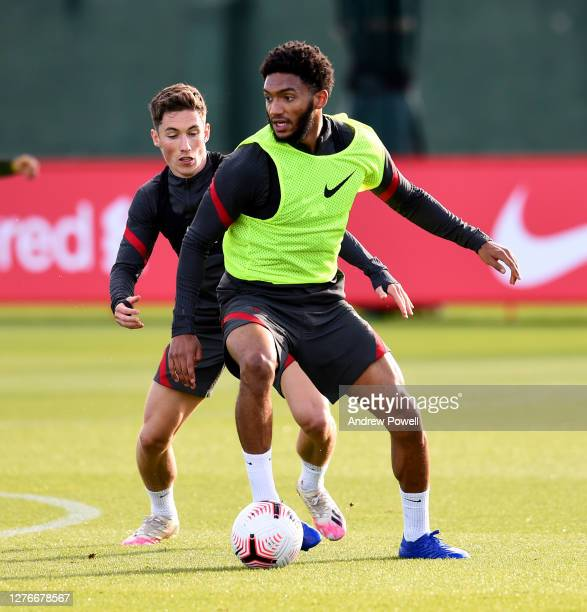 Harry Wilson and Joe Gomez of Liverpool during the training session at Melwood Training Ground on September 25 2020 in Liverpool England
