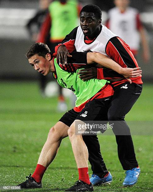 Harry Wilson and Kolo Toure of Liverpool in action during a training session on July 15 2015 in Brisbane Australia