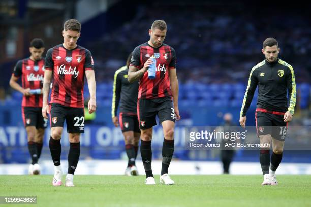Harry Wilson and Steve Cook of Bournemouth leaves the pitch after their side is relegated after the Premier League match between Everton FC and AFC...