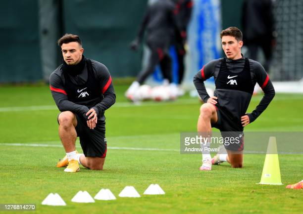 Harry Wilson and Xherdan Shaqiri of Liverpool during a training session at Melwood Training Ground on September 26 2020 in Liverpool England
