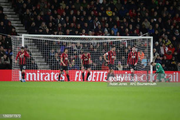 Harry Wilson Nathan Ake Steve Cook Andrew Surman Jack Simpson and Mark Travers of Bournemouth after Arsenal score during the FA Cup Fourth Round...