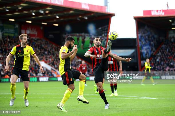 Harry Wilson of AFC Bournemouth and Adrian Mariappa of Watford clash during the Premier League match between AFC Bournemouth and Watford FC at...