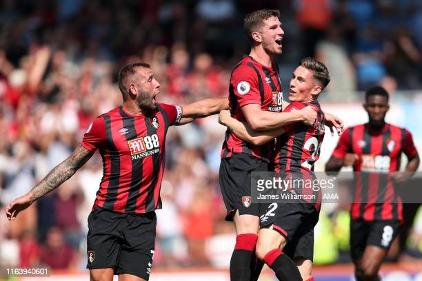 Harry Wilson of AFC Bournemouth celebrates after scoring a goal to make it 1-2 with Chris Mepham and Steve Cook during the Premier League match...