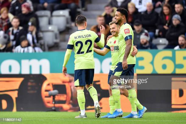 Harry Wilson of AFC Bournemouth celebrates with teammates after scoring his team's first goal during the Premier League match between Newcastle...