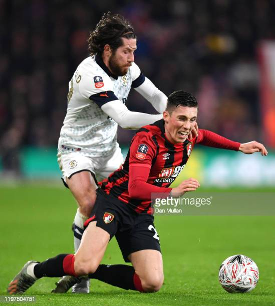 Harry Wilson of AFC Bournemouth is challenged by Jacob Butterfield of Luton Town during the FA Cup Third Round match between AFC Bournemouth and...