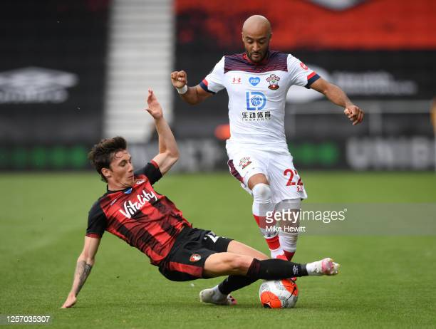 Harry Wilson of AFC Bournemouth tackles Nathan Redmond of Southampton during the Premier League match between AFC Bournemouth and Southampton FC at...