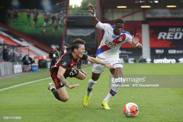 Harry Wilson of Bournemouth and Wilfried Zaha of Crystal Palace during the Premier League match between AFC Bournemouth and Crystal Palace at...