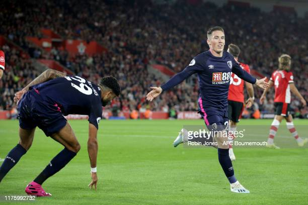 Harry Wilson of Bournemouth celebrates with team-mate Philip Billing after he scores a goal to make it 2-0 during the Premier League match between...