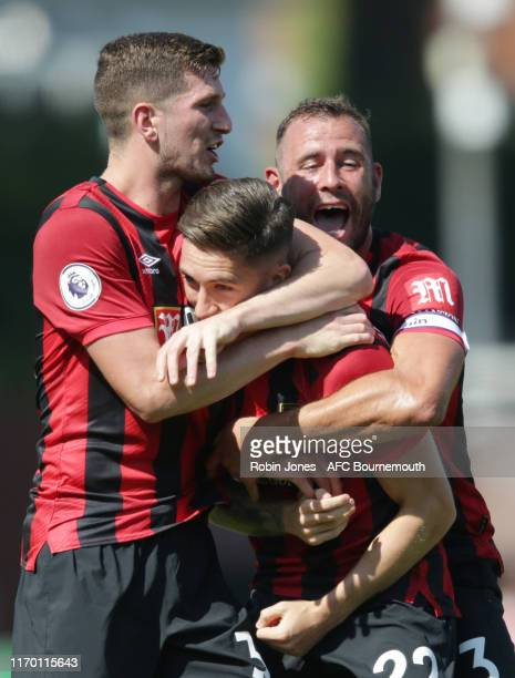 Harry Wilson of Bournemouth is congratulated by team-mates Steve Cook and Chris Mepham after scores a goal to make it 2-1 direct from a free-kick...