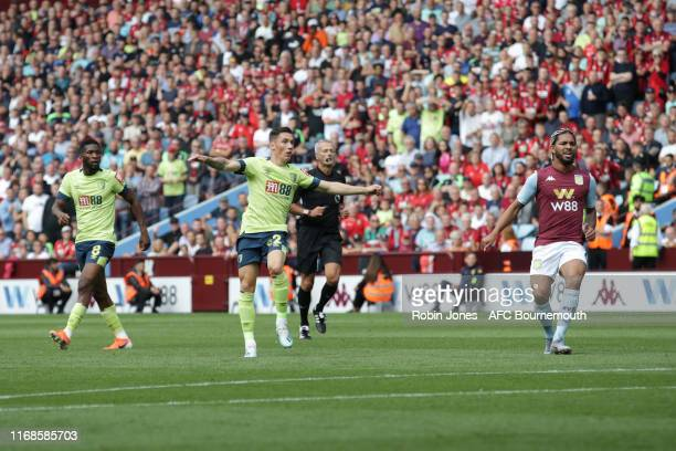 Harry Wilson of Bournemouth watches his shot fly past Thomas Heaton of Aston Villa to score to make it 2-0 during the Premier League match between...