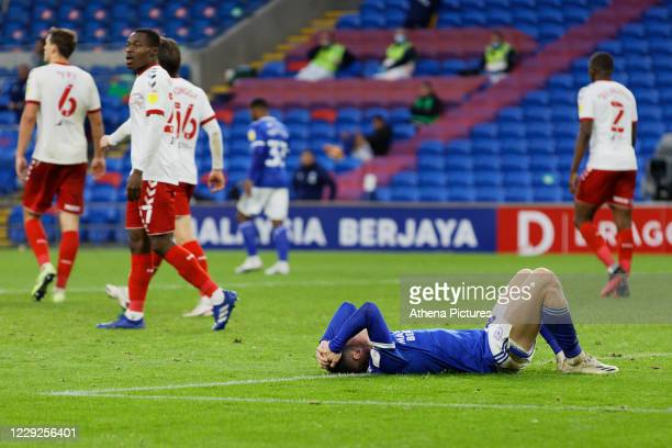 Harry Wilson of Cardiff City lies on the ground in disappointment during the Sky Bet Championship match between Cardiff City and Middlesbrough at the...