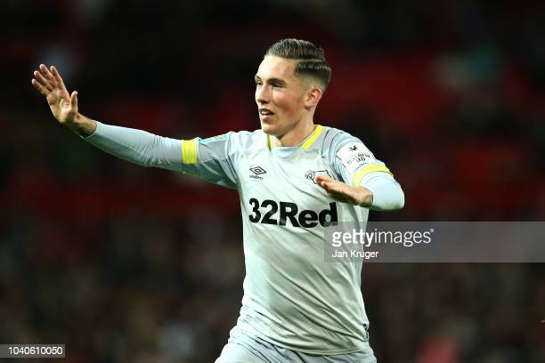Harry Wilson of Derby County celebrates after scoring his team's first goal by holding up five fingers to the Manchester United supporters during the...