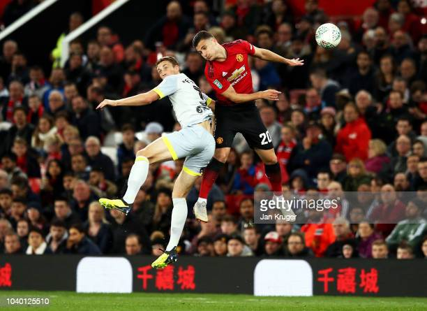 Harry Wilson of Derby County competes for a header with Diogo Dalot of Manchester United during the Carabao Cup Third Round match between Manchester...