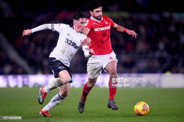 Harry Wilson of Derby County is challenged by Claudio Yacob of Nottingham Forest during the Sky Bet Championship match between Derby County and...