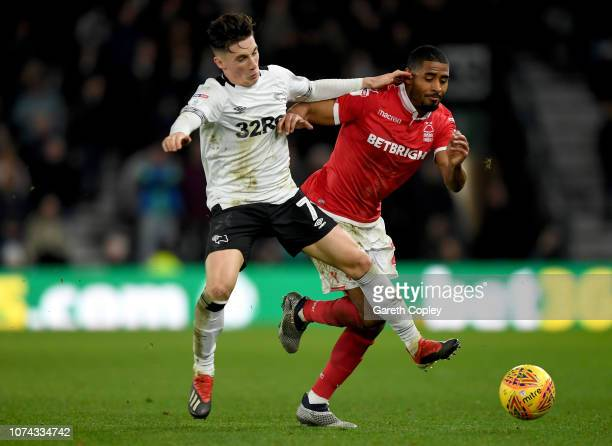 Harry Wilson of Derby County is challenged by Saidy Janko of Nottingham Forest during the Sky Bet Championship match between Derby County and...