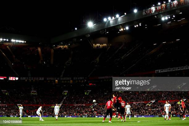 Harry Wilson of Derby County scores his team's first goal during the Carabao Cup Third Round match between Manchester United and Derby County at Old...
