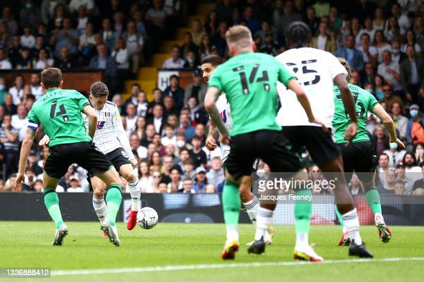 Harry Wilson of Fulham scores their sides first goal during the Sky Bet Championship match between Fulham and Stoke City at Craven Cottage on August...