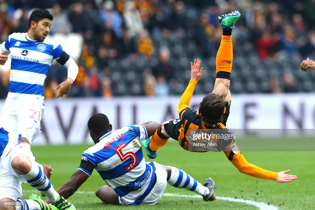 Harry Wilson of Hull City is tackled by Nedum Onuoha of Queens Park Rangers during the Sky Bet Championship match between Hull City and Queens Park Rangers at KCOM Stadium on April 7, 2018 in Hull, England.