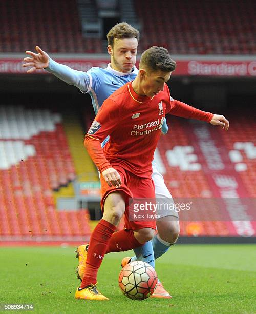 Harry Wilson of Liverpool and Brandon Barker of Manchester City in action during the Liverpool v Manchester City Barclays U21 Premier League game at...