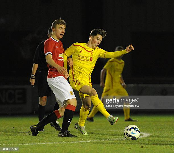 Harry Wilson of Liverpool and Charlie Scott of Manchester United in action during the Barclays Premier League Under 18 fixture between Manchester...