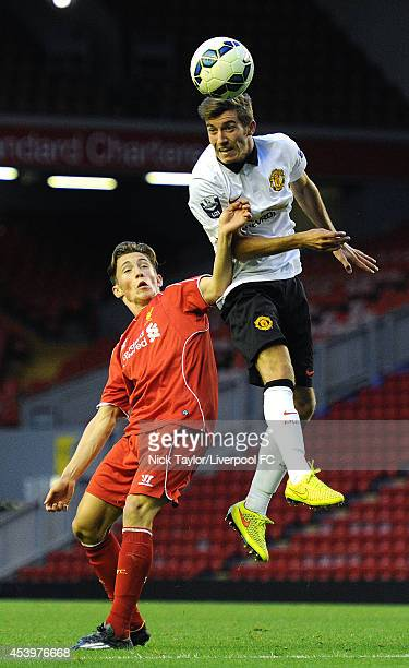 Harry Wilson of Liverpool and Joe Rothwell of Manchester United in action during the Barclays Premier League Under 21 fixture between Liverpool and...