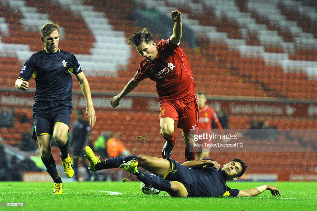 Harry Wilson of Liverpool and Nial Mason of Southampton in action during the Barclays Premier League Under 21 fixture between Liverpool and Southampton at Anfield on October 16 in Liverpool, England.
