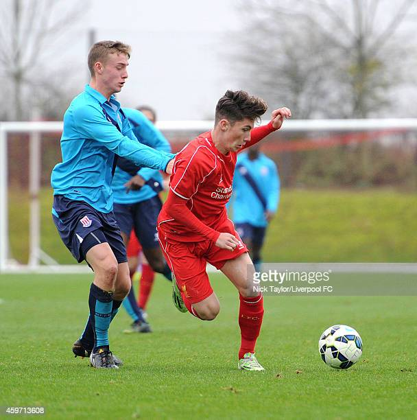 Harry Wilson of Liverpool and Oliver Roberts of Stoke City in action during the Barclays Premier League Under 18 fixture between Liverpool and Stoke...