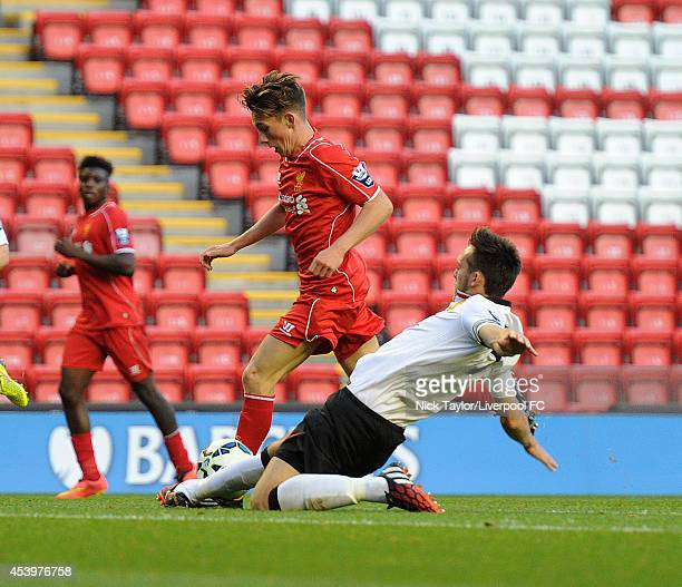 Harry Wilson of Liverpool and Tom Thorpe of Manchester United in action during the Barclays Premier League Under 21 fixture between Liverpool and...