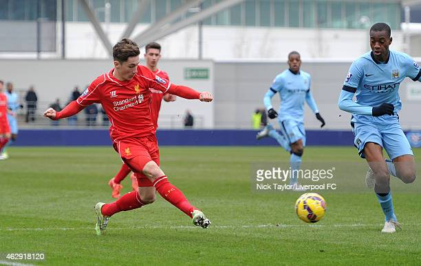 Harry Wilson of Liverpool and Tosin Adarabioyo of Manchester City in action during the Barclays U21 Premier League match between Manchester City and...