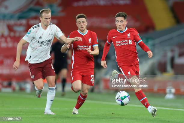 Harry Wilson of Liverpool battles with Rob Holding of Arsenal during the Carabao Cup Fourth Round match between Liverpool and Arsenal at Anfield on...