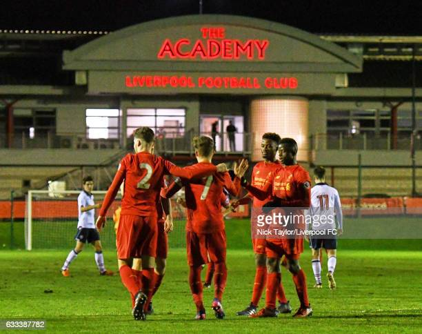 Harry Wilson of Liverpool celebartes scoring his first penalty of the game with team mates Corey Whelan Madger Gomes and Toni Gomes during the...