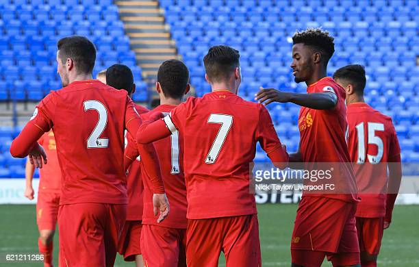 Harry Wilson of Liverpool celebrates scoring from the penalty spot with team mates Corey Whelan and Madger Gomes at Prenton Park on November 5 2016...