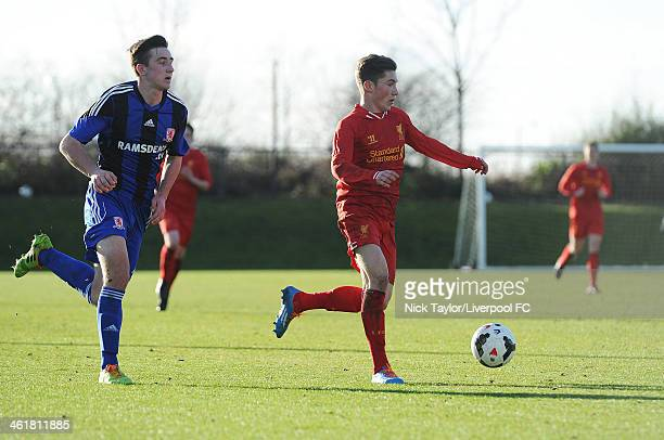Harry Wilson of Liverpool is chased down by Johny Helm of Middlesbrough during the Barclays Premier League Under 18 fixture between Liverpool and...