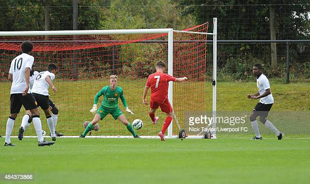 Harry Wilson of Liverpool scores the opening goal of the game during the Barclays Premier League Under 18 fixture between Liverpool and Manchester...