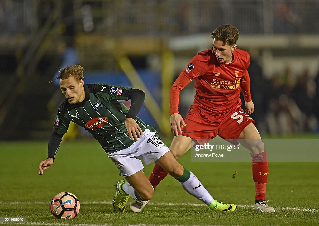 Harry Wilson of Liverpool with Oscar Threlkeld during the Emirates FA Cup Third Round replay match between Plymouth Argyle and Liverpool at Home Park on January 18, 2017 in Plymouth, England.