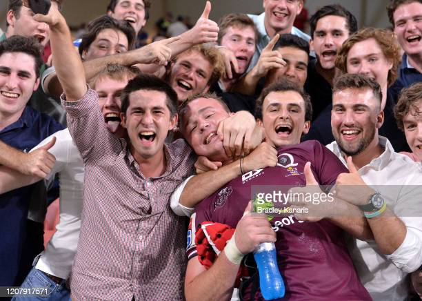Harry Wilson of the Reds celebrates victory with fans after the round four Super Rugby match between the Reds and the Sunwolves at Suncorp Stadium on...