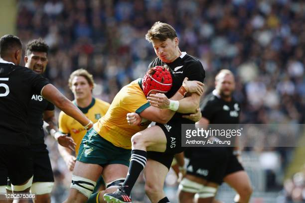Harry Wilson of the Wallabies charges into Beauden Barrett of the All Blacks after his kick during the Bledisloe Cup match between the New Zealand...