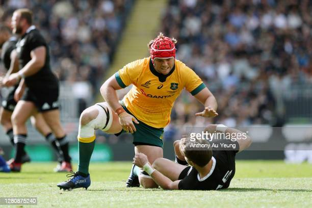 Harry Wilson of the Wallabies pushes down Beauden Barrett of the All Blacks after a tackle on him during the Bledisloe Cup match between the New...