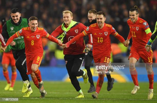 Harry Wilson of Wales Aaron Ramsey of Wales and Gareth Bale of Wales celebrate after the UEFA Euro 2020 qualifier between Wales and Hungary so at...