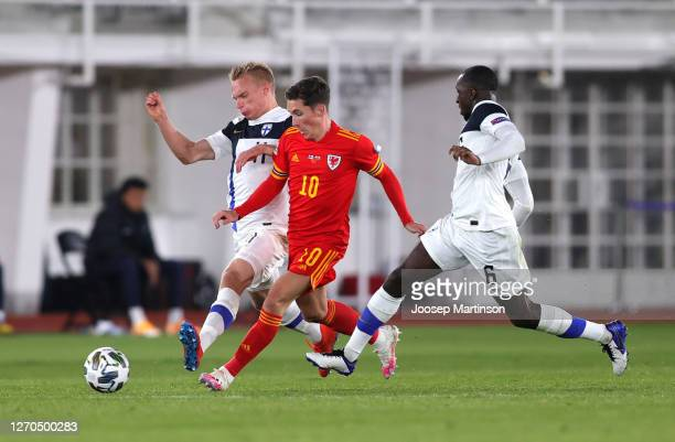 Harry Wilson of Wales battles for possession with Ilmari Niskanen of Finland and Glen Kamara of Finland during the UEFA Nations League group stage...