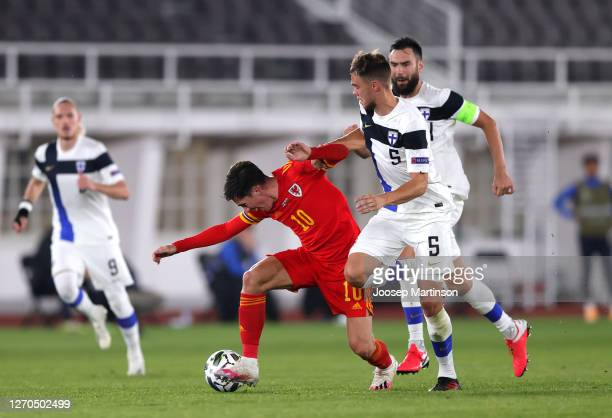 Harry Wilson of Wales battles for possession with Leo Vaaisaanen of Finland during the UEFA Nations League group stage match between Finland and...