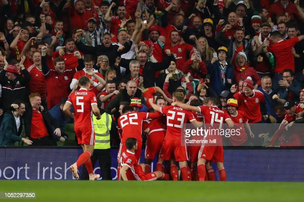 Harry Wilson of Wales celebrates with teammates after scoring his team's first goal during the UEFA Nations League B group four match between Ireland...