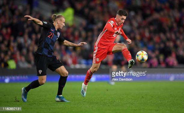 Harry Wilson of Wales gets past Domagoj Vida of Croatia during the UEFA Euro 2020 qualifier between Wales and Croatia at Cardiff City Stadium on...