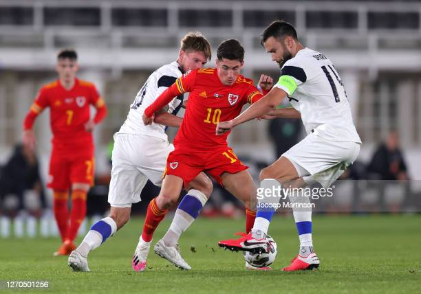 Harry Wilson of Wales is challenged by Tim Sparv of Finland during the UEFA Nations League group stage match between Finland and Wales at Helsingin...