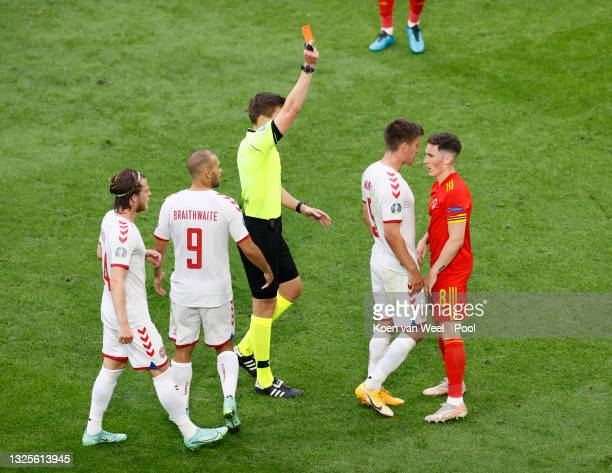 Harry Wilson of Wales is shown a red card by Match Referee, Daniel Siebert during the UEFA Euro 2020 Championship Round of 16 match between Wales and...