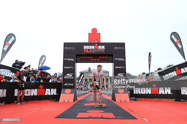 Harry Wiltshire of Great Britain finishes in second place during the Ironman 703 Staffordshire event at the Shugborough Estate on June 12 2016 in...